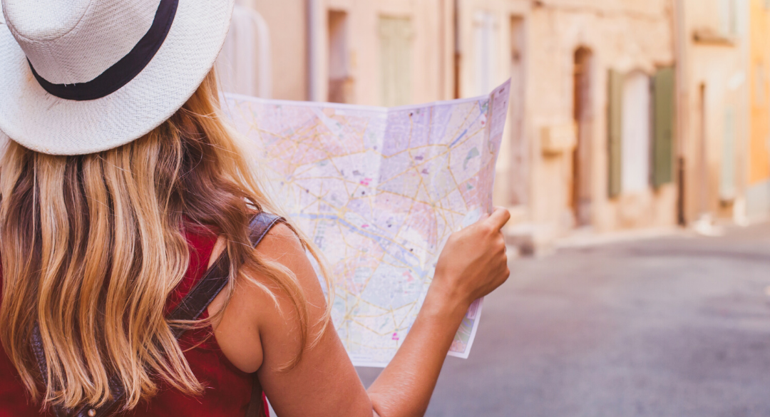 Woman traveling with map