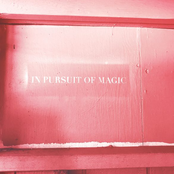 """sign that reads """"in pursuit of magic"""""""