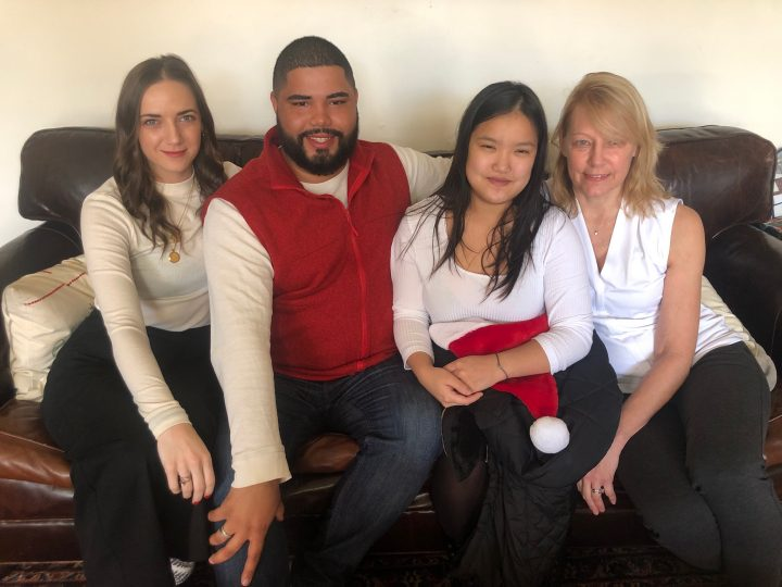 Christopher pictured here with older Caitlin Parker, younger sister Caeliana Parker, and mother Tamara.