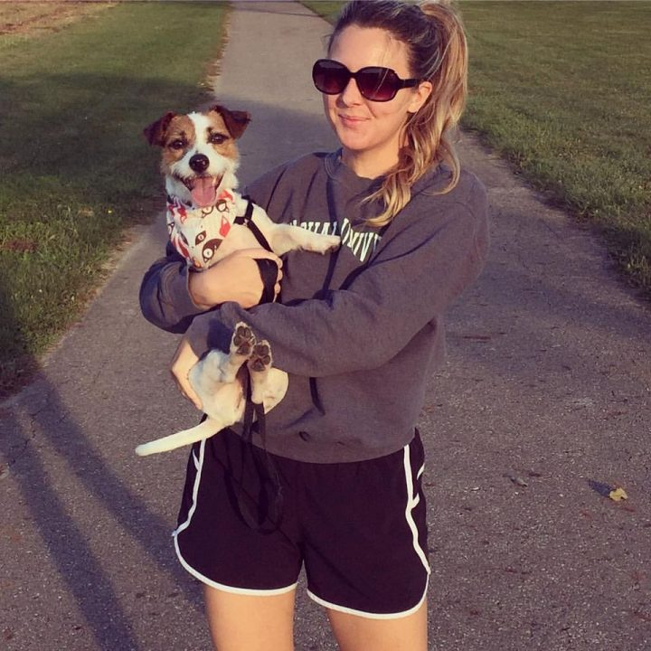 Kristy stands with her pup